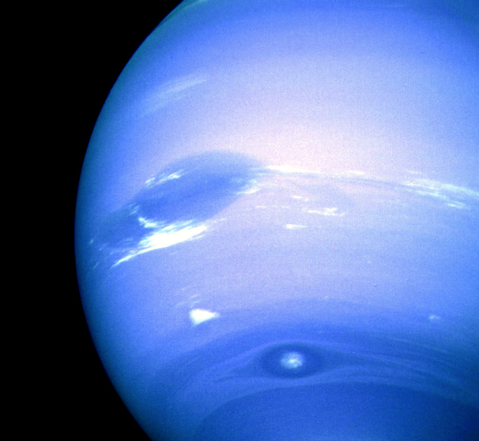 Image of neptune showing several large storms in its atmosphere