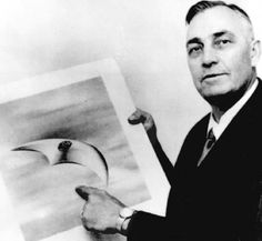 Image of Kenneth Arnold holding sketch of the objects he saw flying