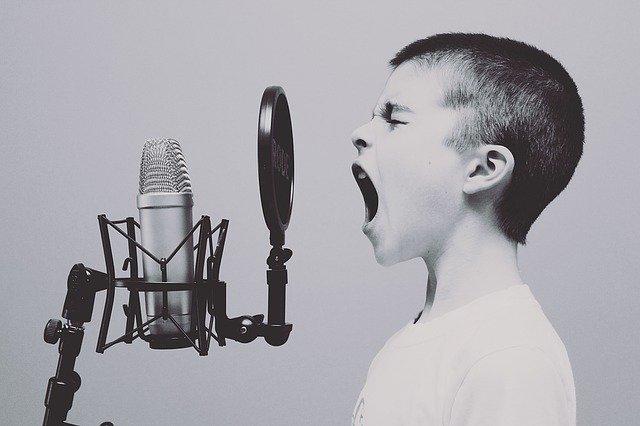 Image of child yelling into studio microphone